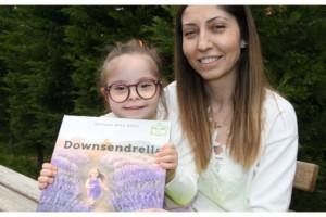Down sendromlu kızı için 'Downsendrella' adlı kitap yazdı